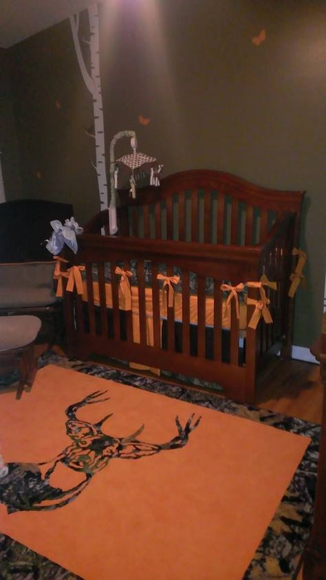 "Even your newest member of the family deserves his/her own ""Hunter cave!!"" Camo and Hunter's orange themed nursery! www.CustomRugsbyDesignFlooring.com"