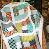 Spin the Bobbin: Hands 2 Help - Quilt Bluebell is the tutorial. Love the large patches to show off larger scale prints.