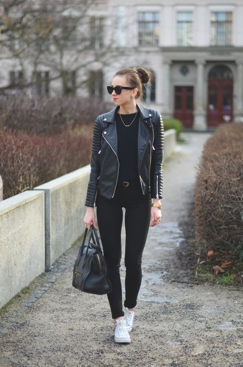 Leather biker jacket with quilted sleeves.