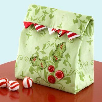 Make the presentation as fun as what's inside! Use a holly leaf pattern and a trio of buttons to add adorable appliqué to a lunch sack gift bag.