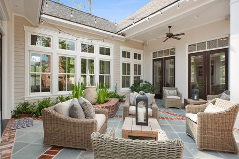 This spacious outdoor living space has a unique water feature and outdoor fireplace making it great for entertaining or just relaxing.