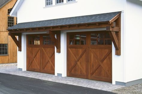 24 Big Sky Timber Frame Eyebrow Roof Over Two 10 X 8 Spanish Cedar Overhead Doors Garage Door Design Garage Exterior Garage Doors