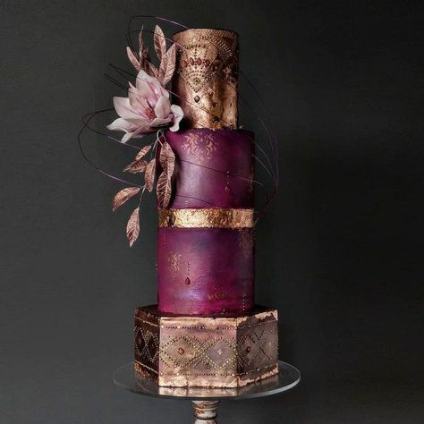 Beautiful handcrafted plum and gold wedding cake