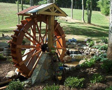 Large and small water wheels built to match your location and needs. Some of my water wheels are designed as moving works of art as they slowly rotate and some of my water wheels are designed to make power so take a look, get ideas, and then contact me so we can design the perfect water wheel for your location.