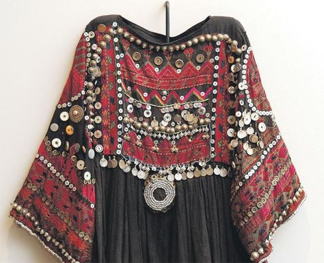 heavily embroidered black and red dress, in boho fashion, with many different beads and sequins
