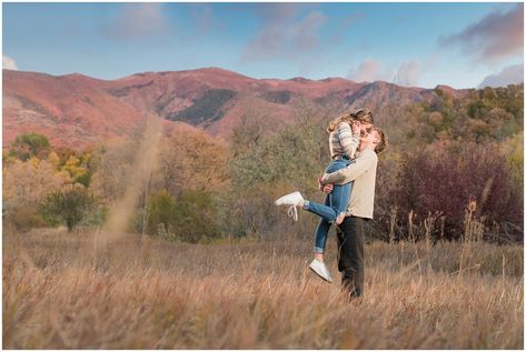 Candid photos of couple in casual cream colored fall sweaters with amazing sunset | Utah Fall Engagement Session in a Golden Field | Jessie and Dallin Photography #utahengagement #utahengaged #utahcouple #utahbride #utahbrideandgroom #utahwedding #utahweddings #utahweddingphotography #utahengagementphotography #fallengagement #utahfallengagement #utahweddingvendors #utahengagementpictures