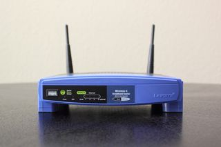 Reuse an old router to bridge devices