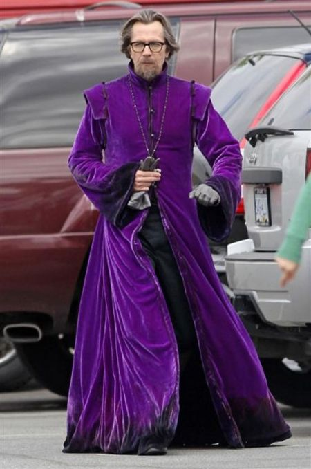 Gary Oldman in a purple velvet cloak .This was taken behind-the-scenes on the set of Catherine Hardwicke's update of Little Red Riding Hood. Gary Oldman plays Father Solomon, the man tasked with tracking down and killing the werewolf.
