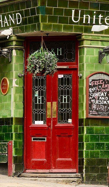 Cherry red door. Brighton, East Sussex, England