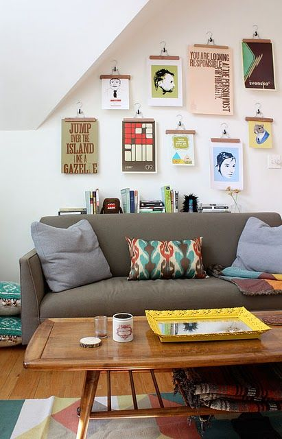 trouser hangers to hang prints // yellow framed mirror tray on lovely coffee table // funky rug, great pillow