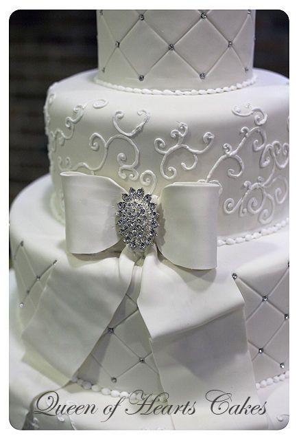 4-tier fondant covered wedding cake.  Gumpaste bow.