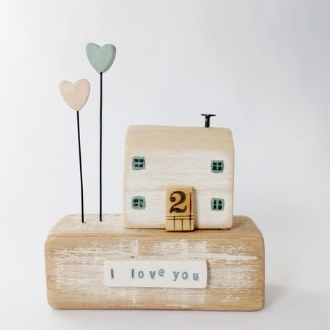 Wooden house with two clay hearts 'I love you' £25.00