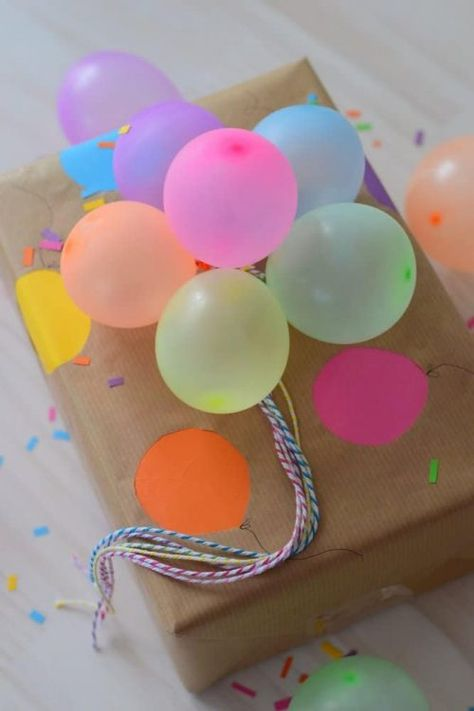 Mini Balloon Bouquet Gift Wrapping Techniques - Gift Guides and Ideas - How to Make a First Impression #FrugalCouponLiving #giftwrapping #giftideas #giftwrap #giftideas #giftwrapideas #giftwrappingideas #present #presents #presentideas