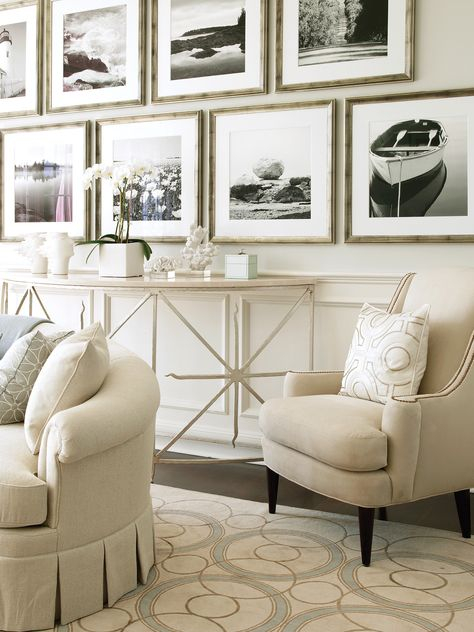 Beautiful neutral upholstered chair and sofa with box-pleated skirt looks modern with black and white framed art. Room by Skye Kirby-Westcott for Lillian August.  Photography by Tria Giovan.