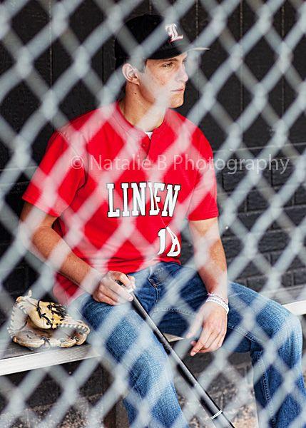 senior boy baseball - through fence
