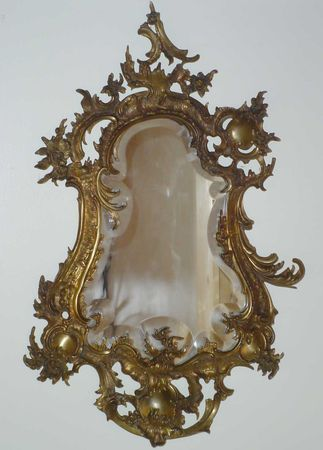 Rococo Mirror. Carved & Gilt Wood & Gesso and Mirrored Glass. France. Circa Late 18th-Century.
