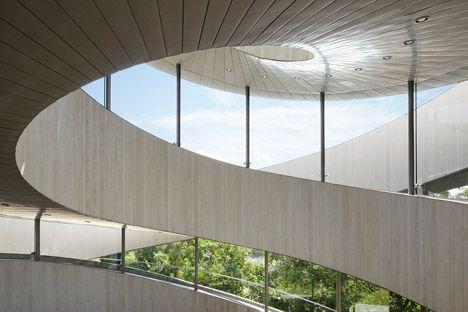 Intertwining staircases spiral around the glazed core of Hiroshi Nakamura's Ribbon Chapel.