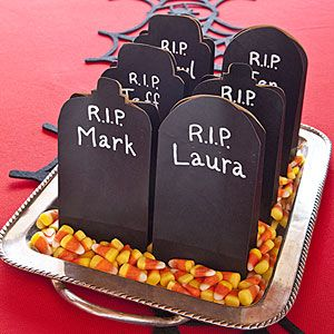 Hand out treats in black paper bags made to look like grave markers. Fill the bags with Halloween candy or dark-chocolate chip cookies.