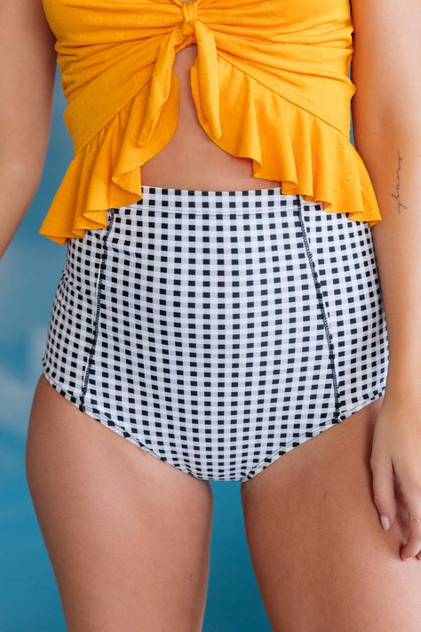 """Wear these darling high-waisted bottoms with a variety of tops to spruce up your swimsuit collection. They have a gorgeous seam detail on the hips to add dimension to the piece. Feel unstoppable in these bottoms after being cooped up inside for way too long! Lightweight + High WaistedGingham Pattern May Lay Uniquely From Bottom To Bottom82% Nylon, 18% Spandex Wash Cold, Hang Dry Fits True To Size*Measurements listed below are of the actual clothing item.* XXS: Waist 20"""" Hips 24"""" Rise 14.5""""XS: Wa"""