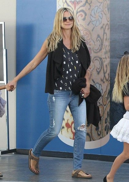 Supermodel Heidi Klum and her boyfriend Martin Kristen take her kids Leni, Henry, Johan, and Lou along with some of their friends to the movies at the mall in Century City, California on August 4, 2013.