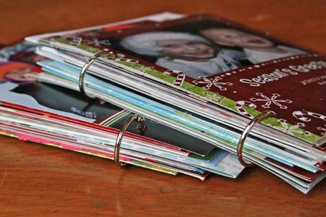 save all the old picture cards you receive, punch a few holes in them and add rings to keep them together...use as coffee table books at the holidays!!!