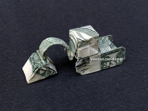 Hello, Up for sale is a beautifully crafted Origami Excavator. It's made from a brand new dollar bill.