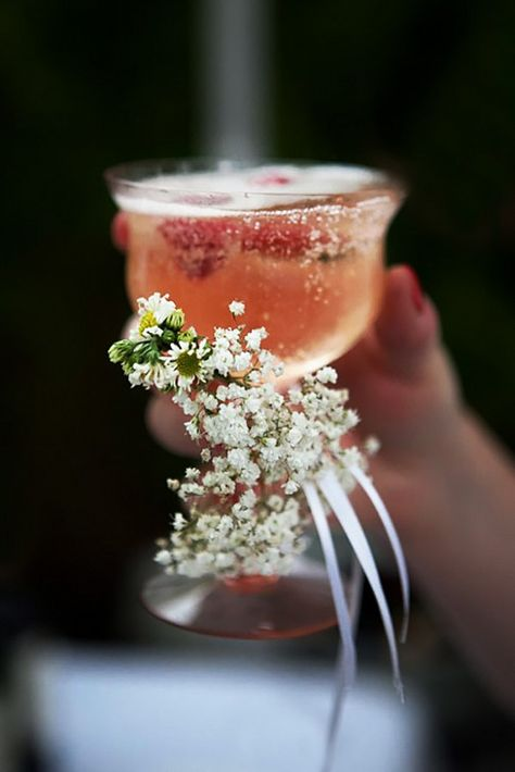 tiny flowers tied to champagne glasses