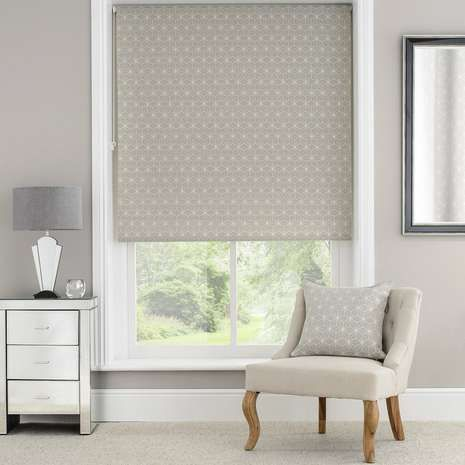 Designed with a modern woven geometric print against a neutral background, our Astra roller blind is crafted with a daylight lining that is perfect for increasing privacy whilst allowing natural light into the room.