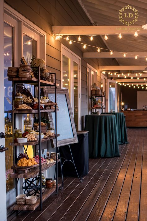 Wedding cocktail hour with string lights, tall hunter green tables, and fall charcuterie station held at The Cordelle in Nashville, Tennessee #cocktailhour #stringlights #wedding