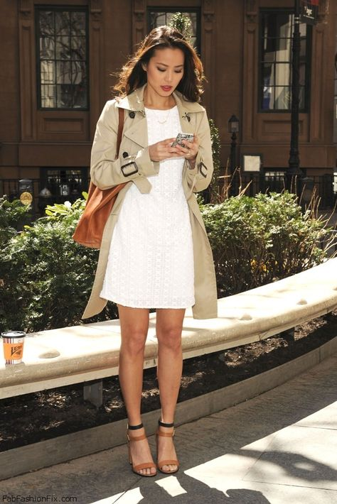 Jamie Chung spring street style with white dress and trench coat. This is a flawless outfit.