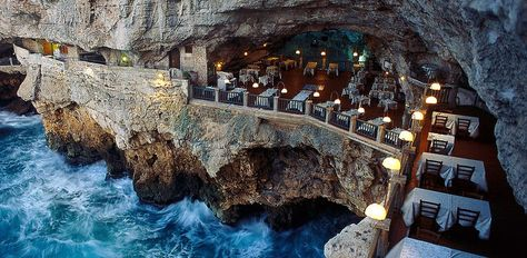 The Grotta Palazzese in Puglia off the Amalfi Coast is set inside a carved-out limestone cave with a view of the Sea