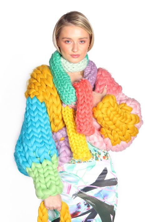 Handmade from merino wool, the Chunky Knit Corinthian Scarf is a colourful accessory to add to your winter wardrobe.