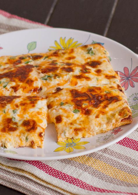 Cheesy Flat Breads - it's cheesy, it's gooey, it's delicious, it's your next snack.