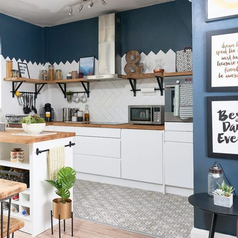 Kitchen makeover with white units, herringbone metro tiles and blue walls