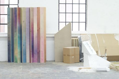 """German designer Meike Harde Harde clamps birchwood sheets to a waterproof frame, washing the wooden surfaces with pigmented water that soaks and tints the wood. The pigmented water creates an effect she likens to """"translucent ink."""