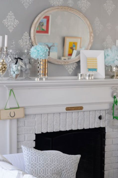 Loving the monotone gray/white look, and  white fireplace mantel of painted brick.