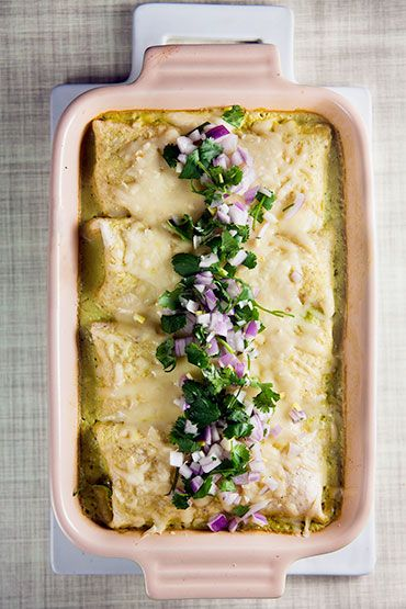 Shredded chicken enchiladas covered in a creamy poblano sauce. Make plenty, because they're even better the next day!