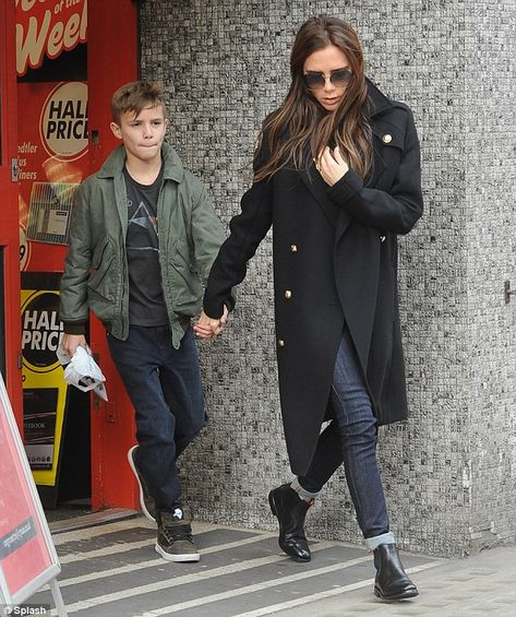 Victoria! Beckham makes a rare outing minus her heels as she steps out in flat Chelsea boots with son Romeo