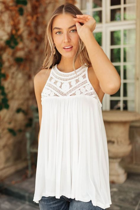 """The darling crochet detail on the Crochet Dreams Halter Tank makes this top a perfect statement piece! The halter detail and flowing body gives this top a beautiful silhouette. Pair this with slim fit jeans and a cute cardigan!Lightweight + Crochet Detail Double Button Closure In Back94% Rayon, 6% Spandex Wash Cold, Hang Dry Fits True To Size *Measurements listed below are of the actual clothing item* XS: Chest 34"""" Length 25""""S: Chest 36"""" Length 25.5""""M: Chest 38"""" Length 26""""L: Chest 40"""" Length 27"""""""