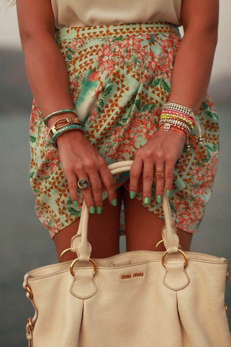 minty nail and patterned skirt