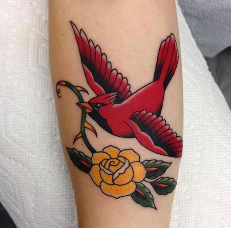 Cardinal with yellow rose