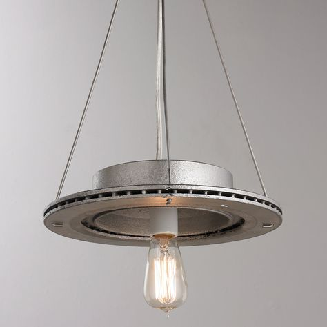 "A fresh take on our reclaimed and repurpose automotive rotors pendants. We took our classic rustic rotors and added a silver finish for a more refined industrial look. These fixtures will surely add an unexpected ""green"" flair to your space, whether they are used alone or in multiples. A one-of-a-kind pendant, this piece will bring pizzazz to any space! 3 feet of chain. No two pendants a-like. 75 watts (medium base socket).(22""Hx10""W) (each piece is one of a kind so measurements are approximate) Automotive Shops, Automotive Furniture, Automotive Decor, Car Part Furniture, Diy Furniture Projects, Recycled Furniture, Furniture Design, Pipe Furniture, Handmade Furniture"
