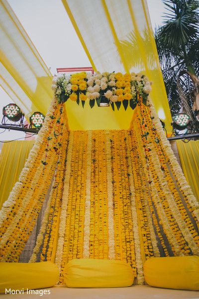 Stunning Indian mehndi party flowers decoration. by