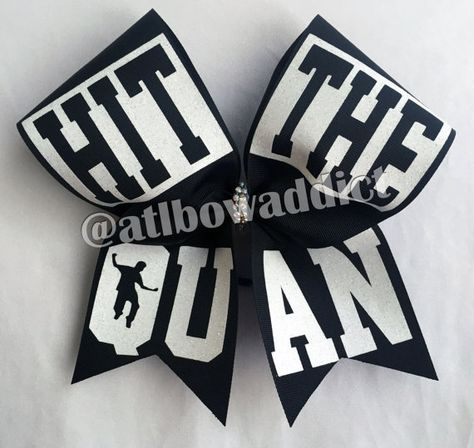 An adorable black cheer style bow with white glitter design. If you would like to change any of the colors contact me so we can discuss options =)