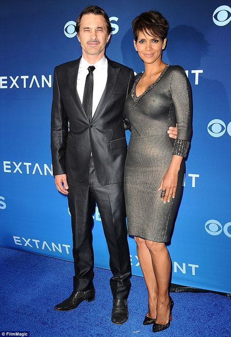 Actor Olivier Martinez and actress Halle Berry attend the premiere of Extant at California Science Center on June 16 2014 in Los Angeles California