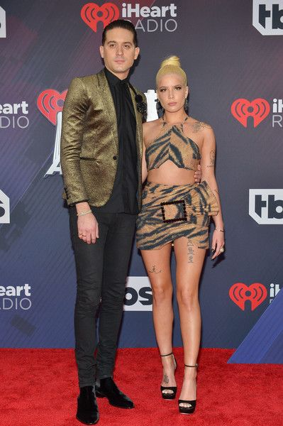 G-Eazy (L) and Halsey arrive at the 2018 iHeartRadio Music Awards which broadcasted live on TBS, TNT, and truTV at The Forum.