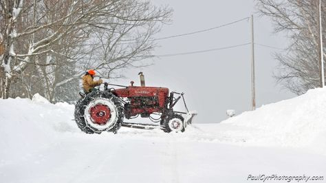 Clearing Snow with an old Tractor.    Paul Cyr Photography:  http://www.crownofmaine.com/paulcyr/olympus-daily-photos/