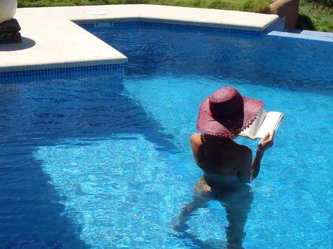Enjoying a good book in the pool at Villa Montemeru