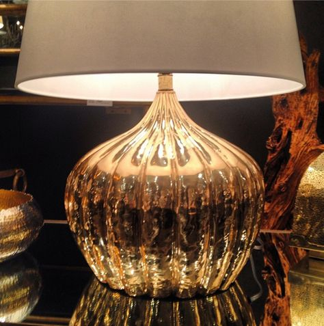 High shine and organic shapes = a new take on glam. This super-sized big, beautiful gourd table lamp creates an instant impact and feels more classic than trendy, thanks to its nature inspired form. Arteriors IHFC #H320