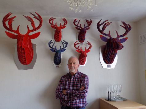 A range of wall mounted stag heads clad in Harris Tweed.